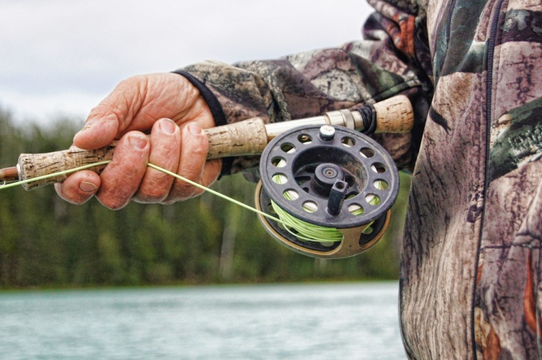 fisherman-fishing-reel-river-39854